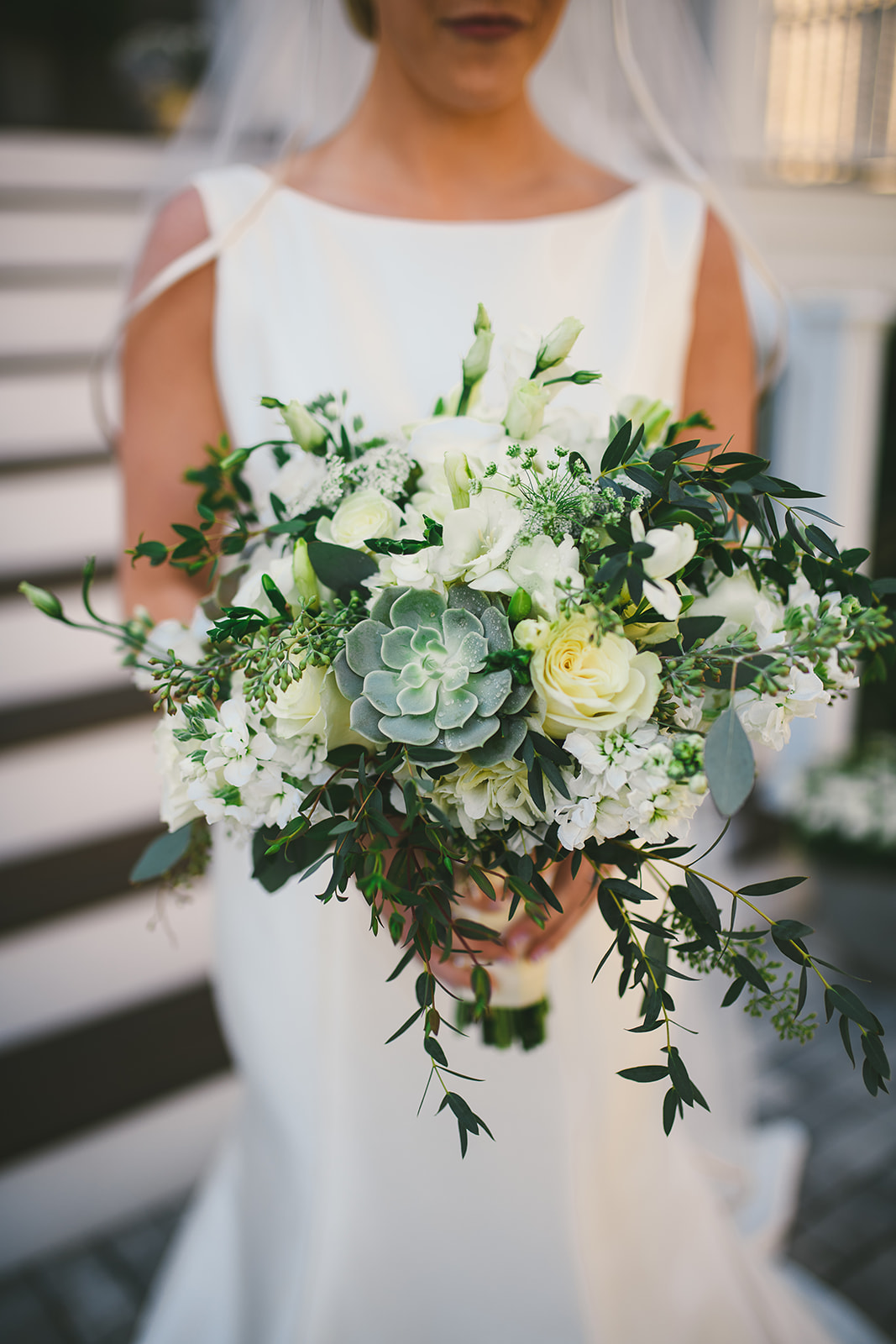 26 Bride holding summer wedding flowers.jpg