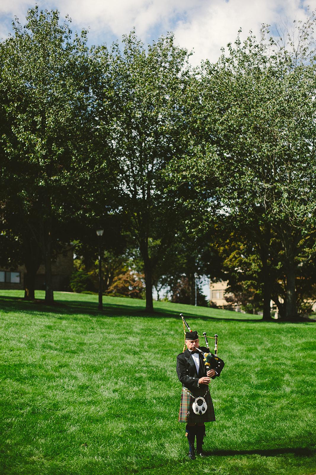 8 bagpiper at fairfield university wedding .jpg
