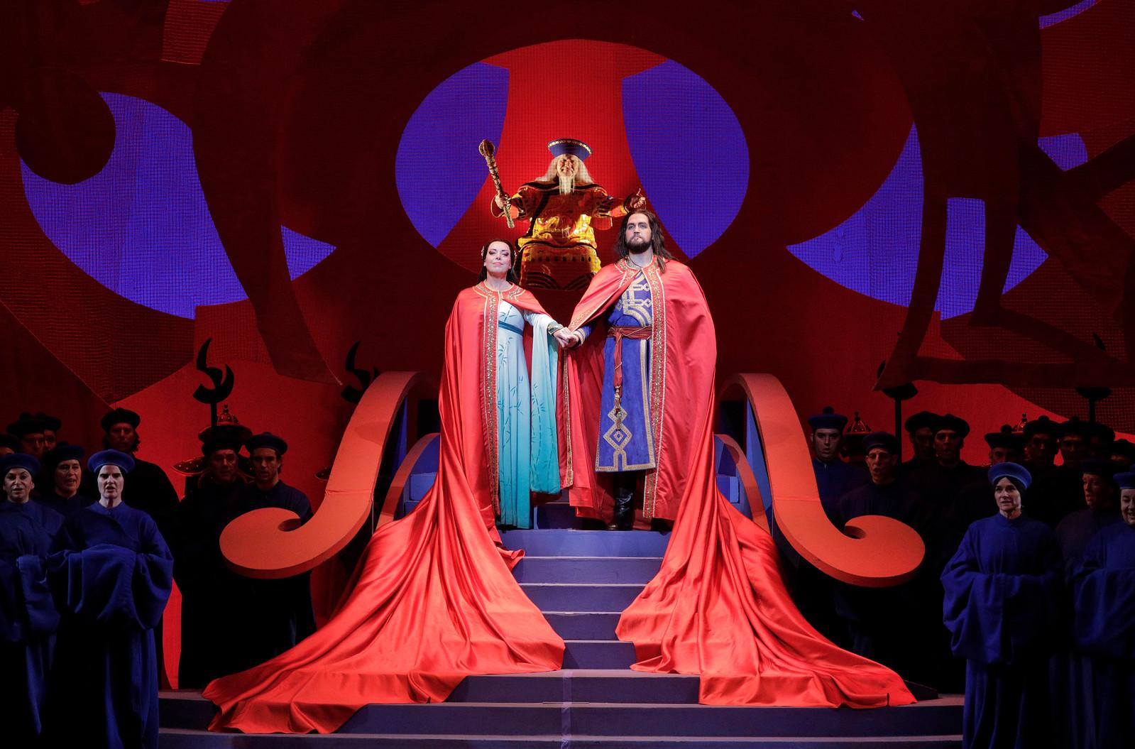 Nina Stemme as Princess Turandot and Brian Jagde as Calaf, with Robert Brubaker as Emperor Altoum