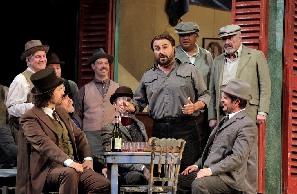 "Roberto Aronica as Turiddu (center) in ""Cavalleria Rusticana."""