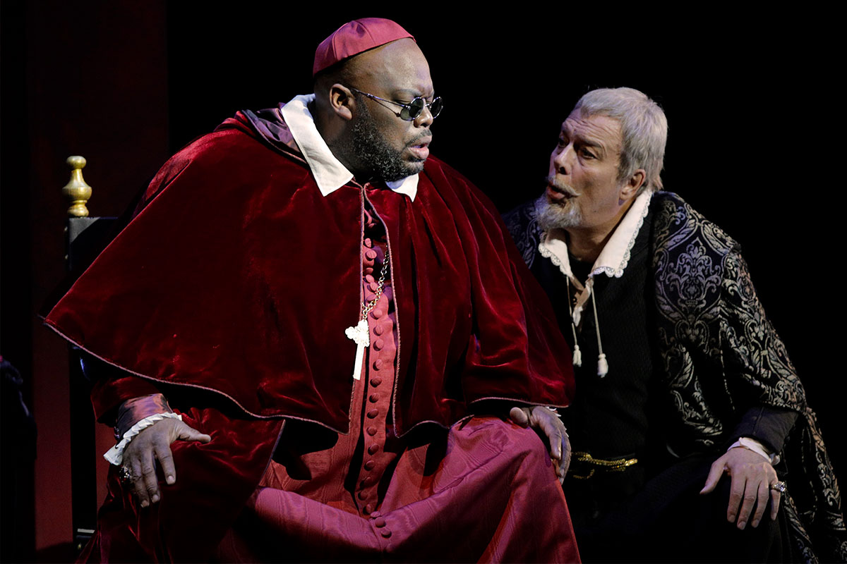 (L) Morris Robinson as Inquisitor, (R) Ferruccio Furlanetto as King Philip II