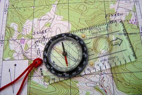 27234027-the-compass-lies-on-the-modern-world-map.jpg