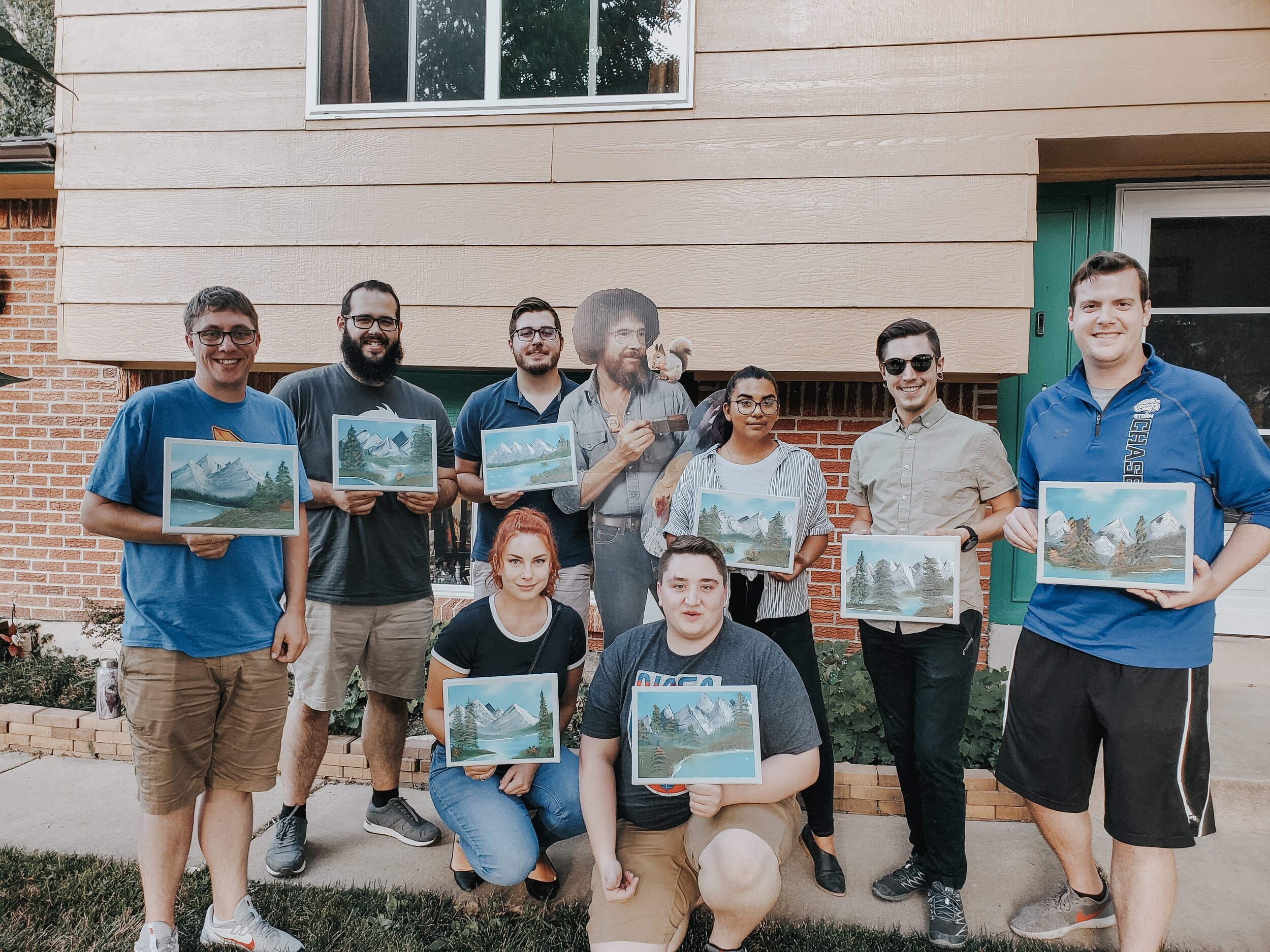 All 8 of us and our paintings! Let us know in the comments which one you think is the best!