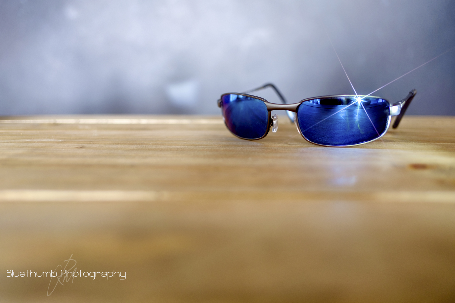 This was shot again on the XT1 and 18mm at f/2 ISO 200 1.3 sec. spot metered for the table top and camera on a tripod. The light source for this was a Led Lenser Cree LED torch shone at an angle directly onto the sunglasses lens.