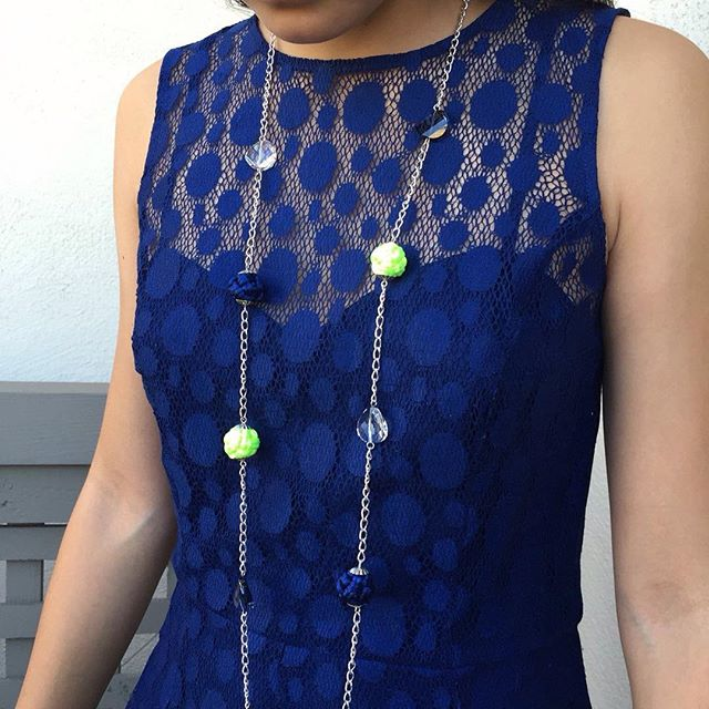 Handmade Globe Knots necklace and earrings on a lace dress