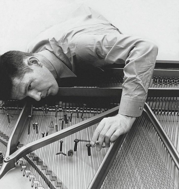 John Cage preparing a piano, in 1947.