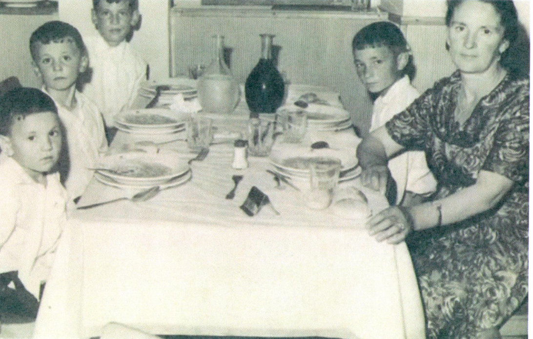 My father (left) and his family in the dinning room during the crossing from Naples to Halifax.