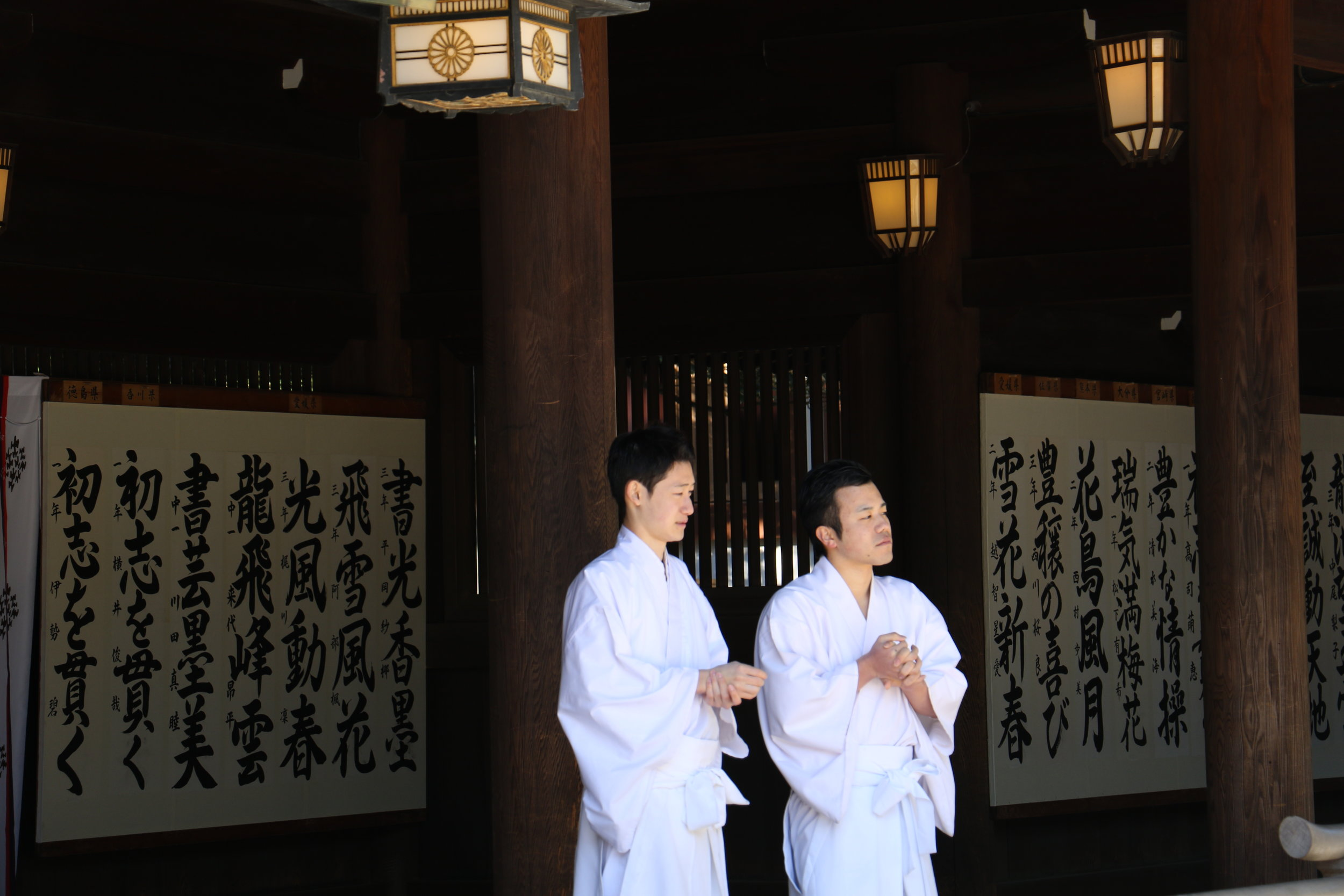 Two monks await a private ceremony at Meiji-Jingu.