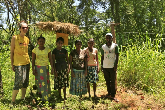 Kylie Butler and Supun Herath (field assistant) with Mrs. Ghanawathi and her family - our newest beehive fence farmers. Mrs. Ghanawathi supports her family alone since the passing of her husband a few years ago, tending the fields and protecting the house. She lives at the edge of Dewagiriya Village, with a forested area along one side of her house and a water tank along the back - making this a prime area for elephant visitation.