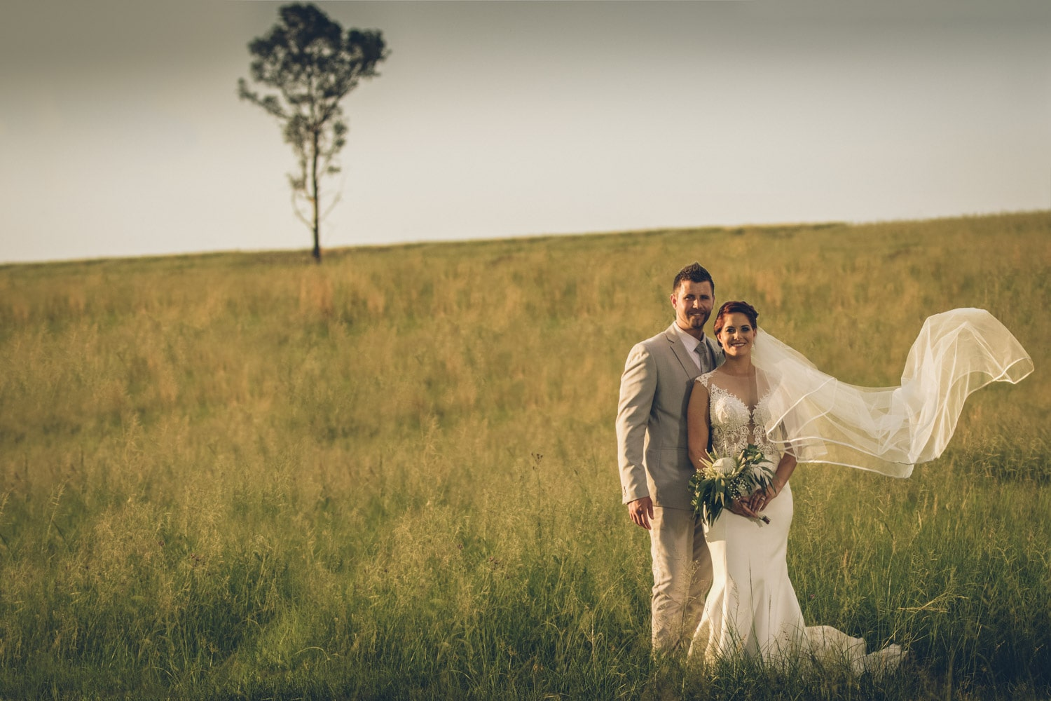 Bride and groom in field.jpg