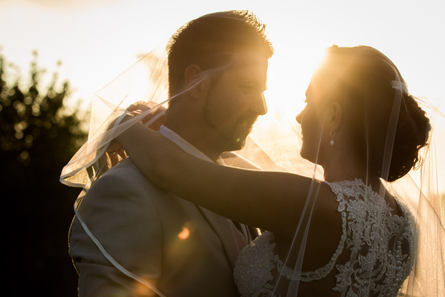 Close up of bride and groom with sunlight.jpg