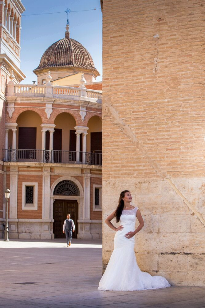 Bride posing in front of old brick building.jpg