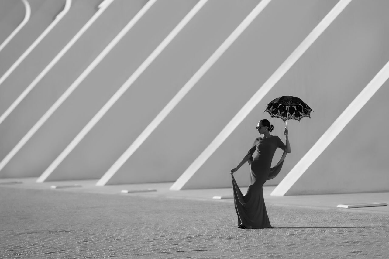 Avont garde photo of female posing with umbrella.jpg