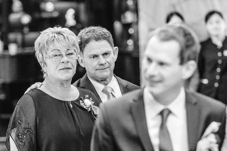 Parents of the groom looking at their son at his wedding.jpg