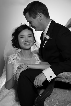 Bride with a beautiful smile posing with her husband.jpg