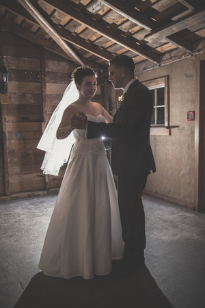 Full length shot of bride and groom having their first dance.jpg