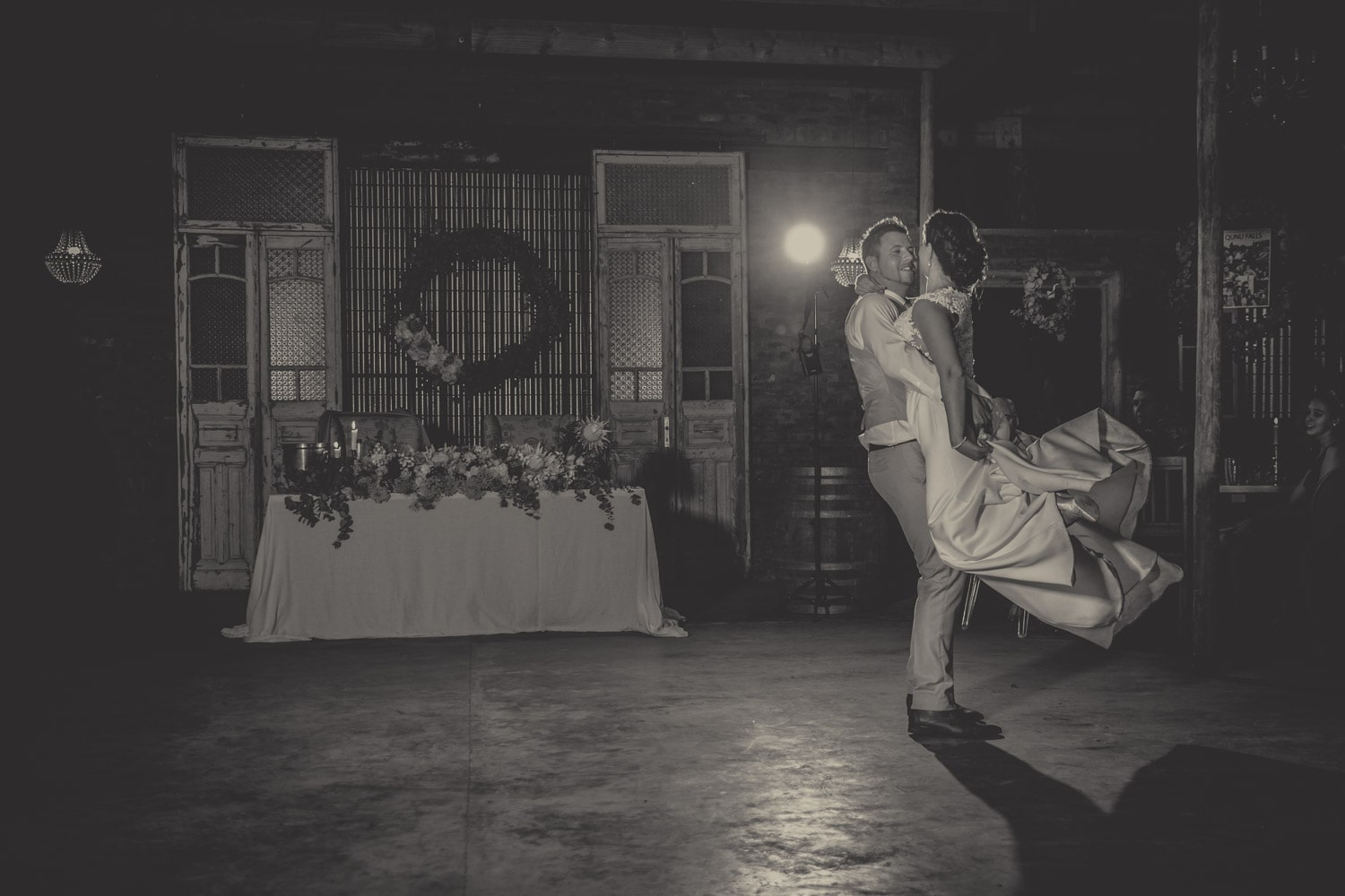 Groom picking bride up during their  first dance.jpg