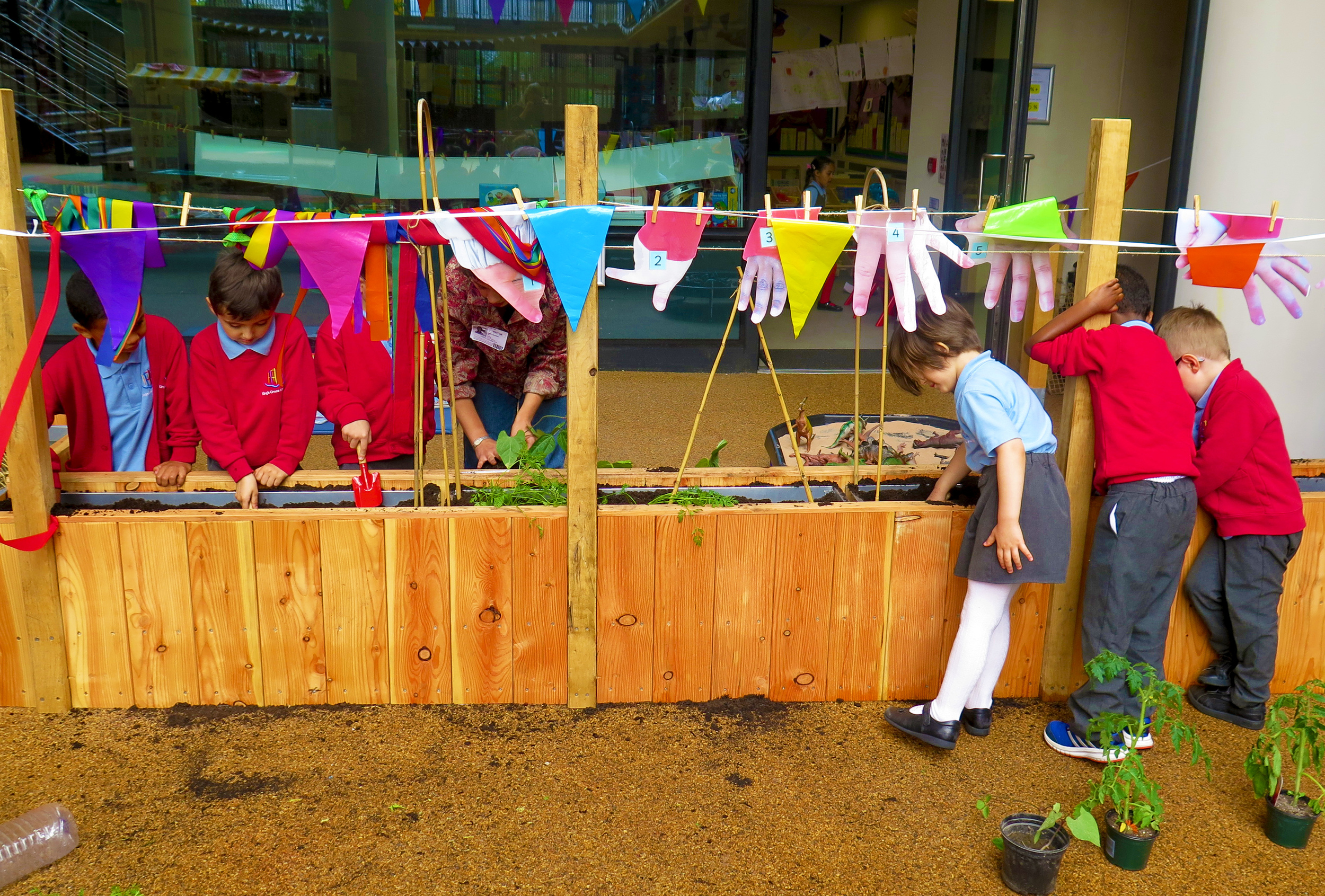 The King's Cross pupils planting their first plants in their new school garden.