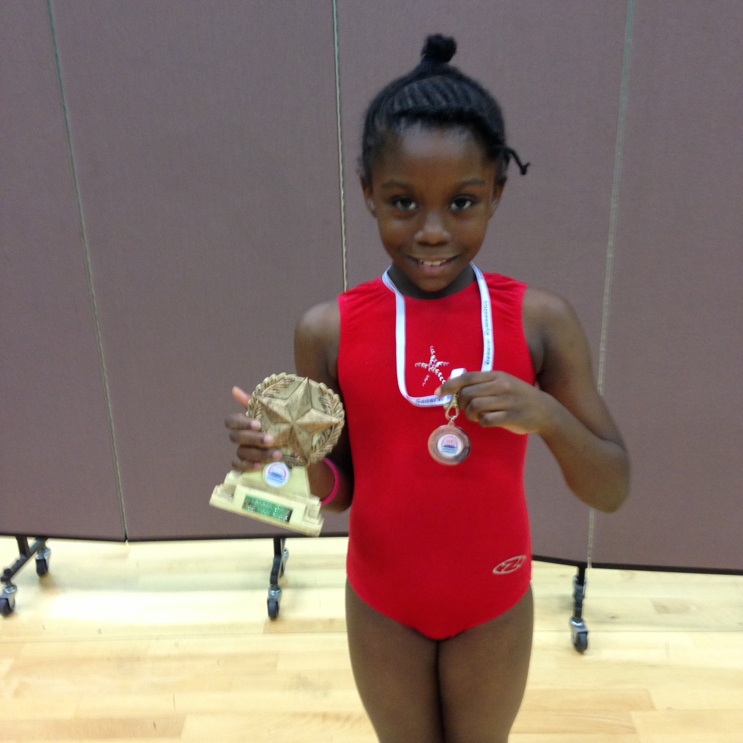 Adonia with medal and trophy.JPG