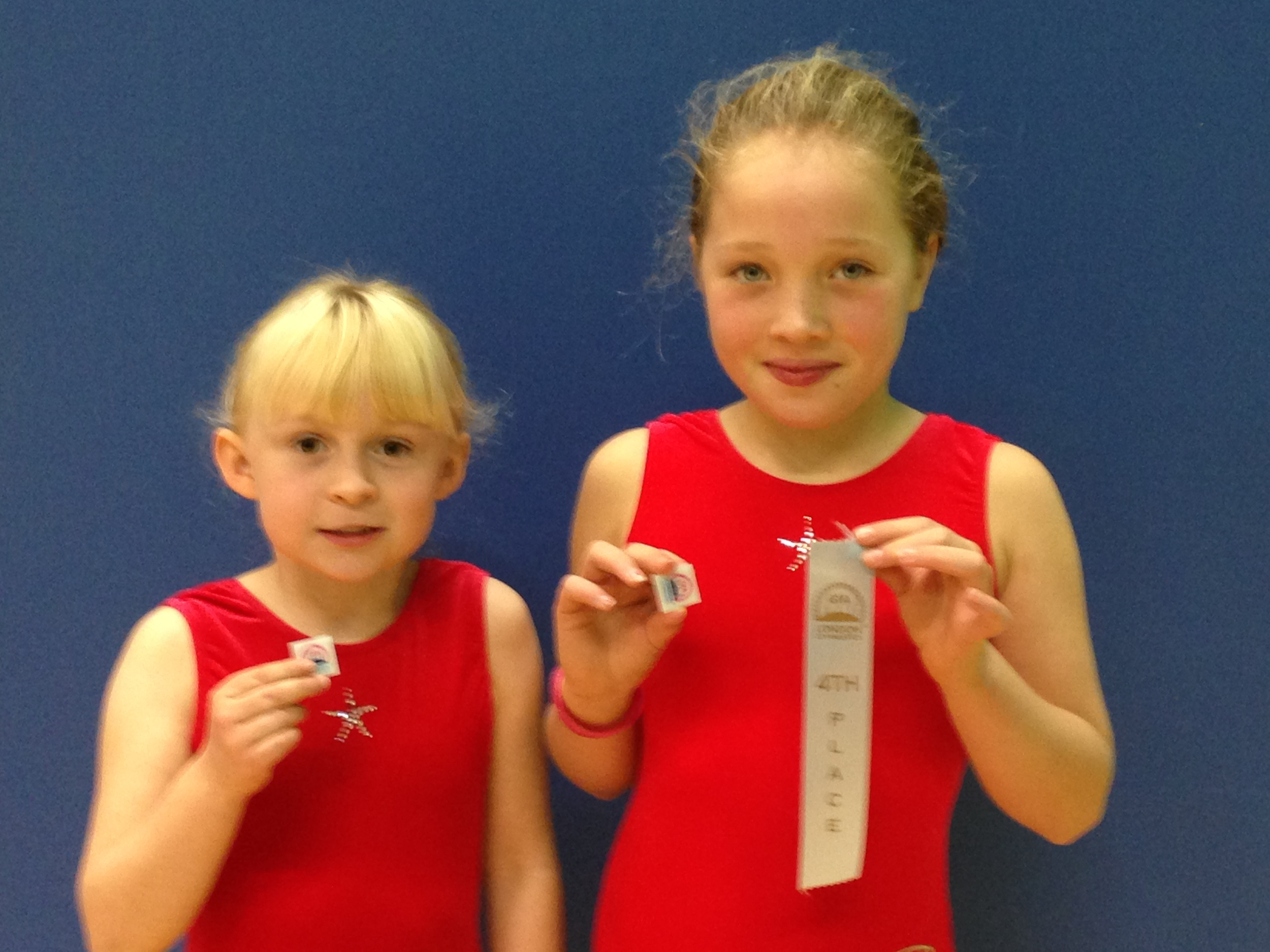 Polly and Kaylin with pins and ribbon.JPG