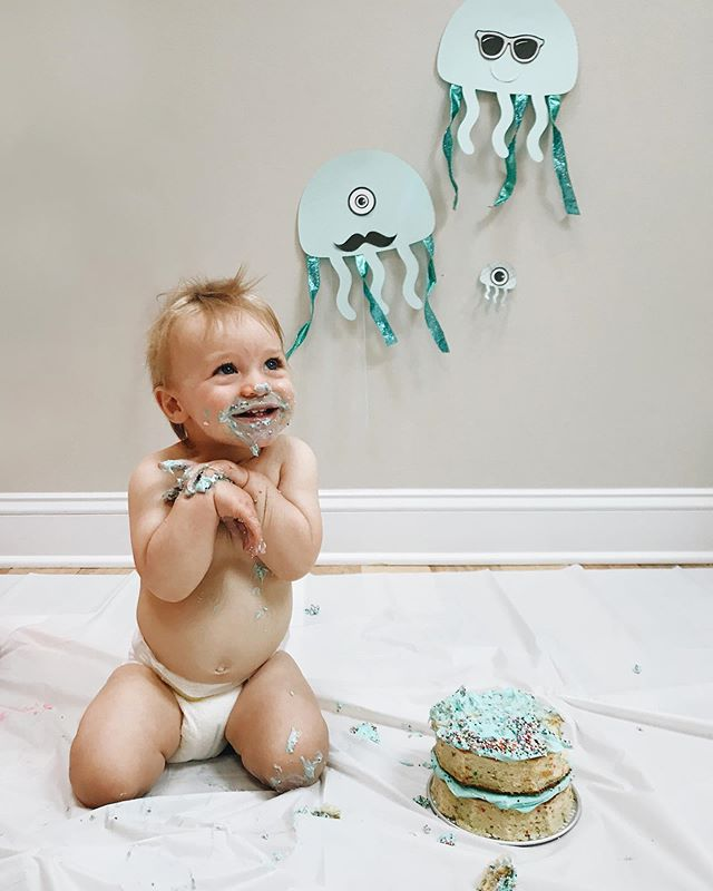 When your party ends with eating cake on the floor, naked, while everyone cheers 🎉 I can't believe my baby turns ONE this week 😭 Swipe to see Landon trying to make a move on his cousin's cake, too 😂
