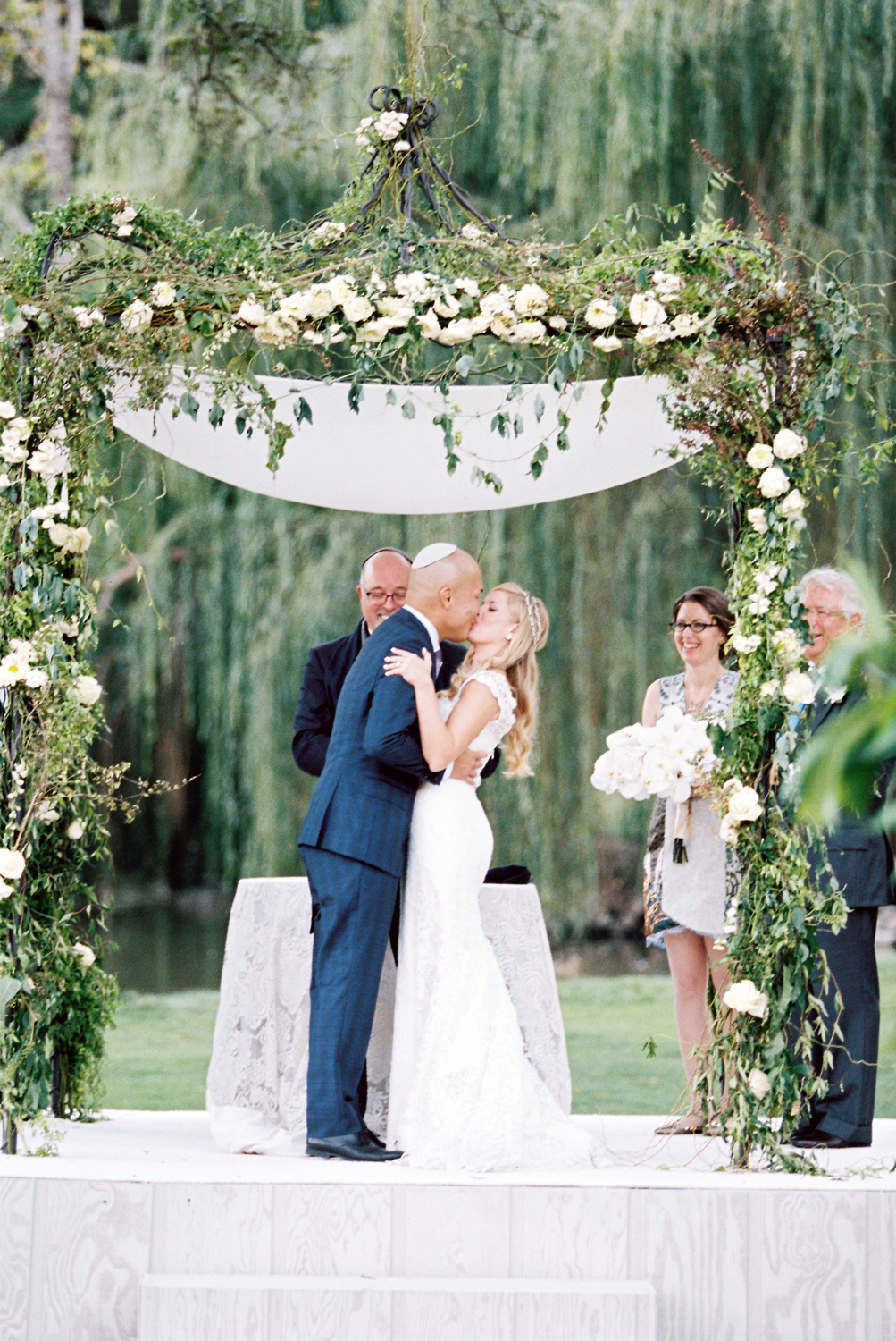 08-the-wedding-chuppah-looked-perfectly-elegant-with-greenery-and-white-flower-decor.jpg