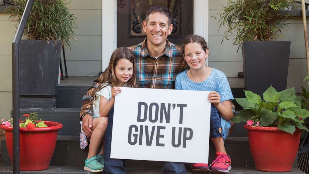 Colby Wallace poses with his two daughters, Caelyn and Chloey in an undated photo.