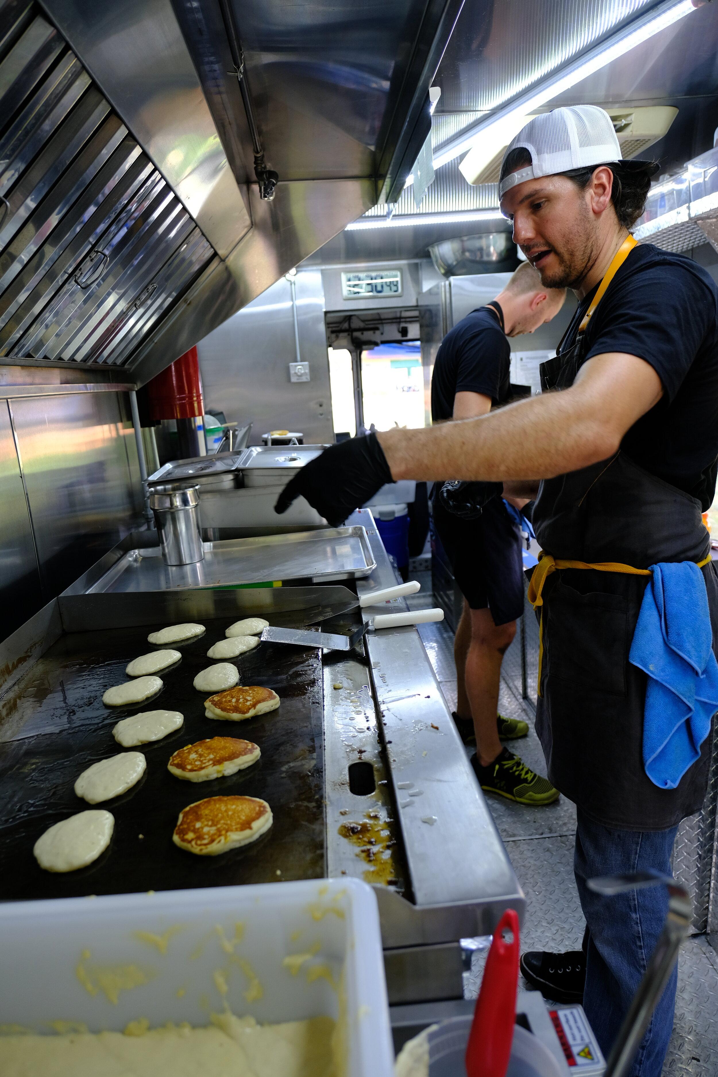 Ortiz making pancakes.  Photo Courtesy of Joaquin Ortiz
