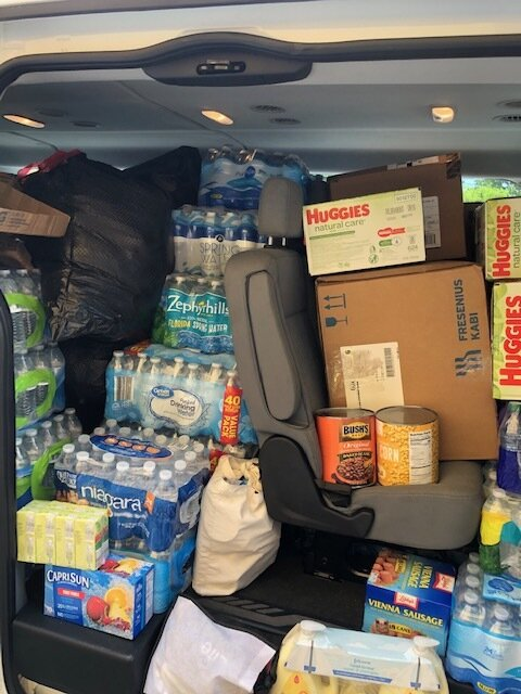 The back of one van with supplies for the Bahamas.  Photo Courtesy of Jonathan Burrows