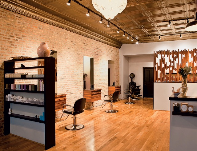 """""""Finally, a reason to have your hair cut in Logan Square. Bathsheba Nemerovski and Susan Flaga's Sparrow is housed in a 120-year-old Building which used to be an old-school barbershop. The super-trendy salon has preserved some of the space's original wallpaper, sinks and tin-ceilings. Appointment is a must."""""""