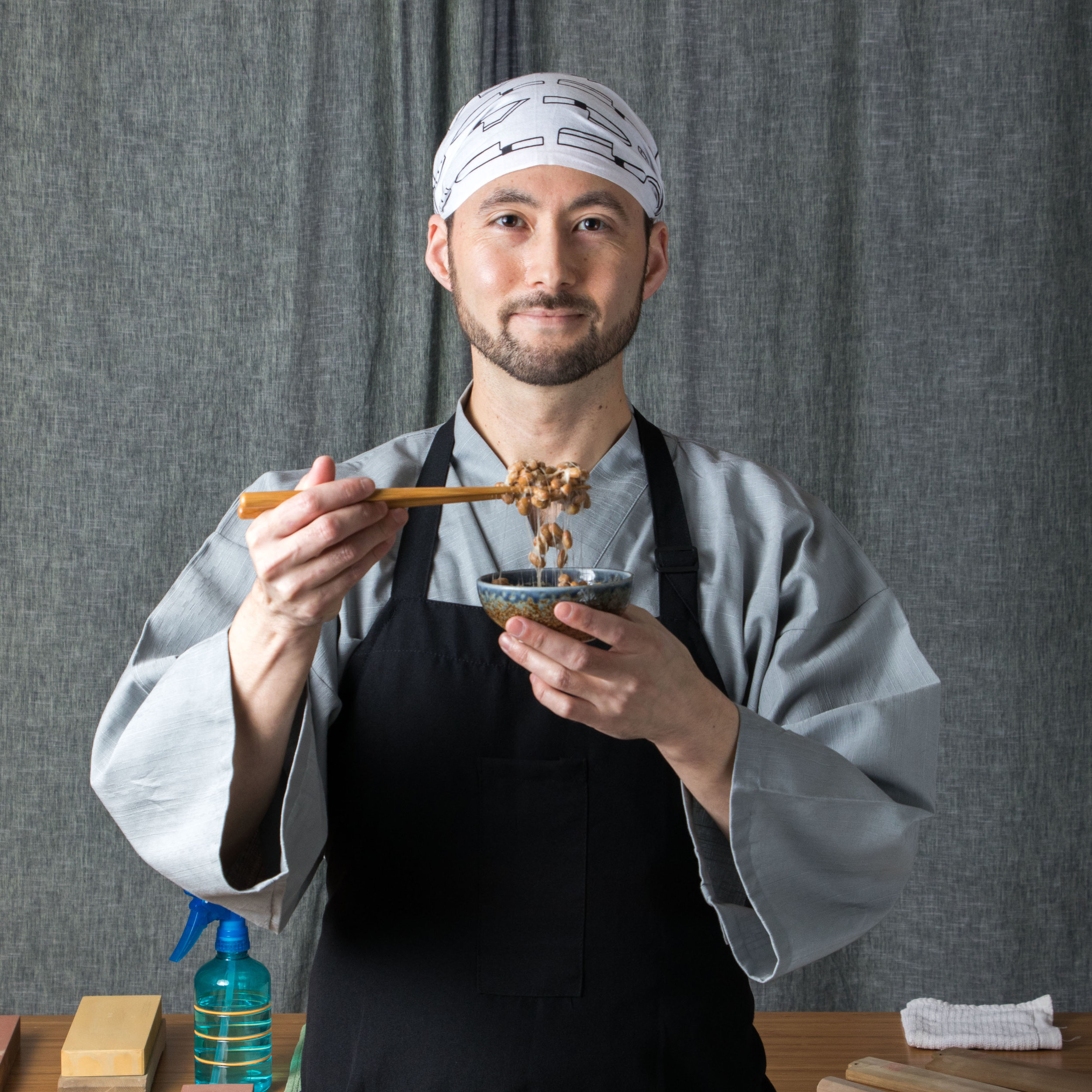 Eien natto in black apron square.jpg