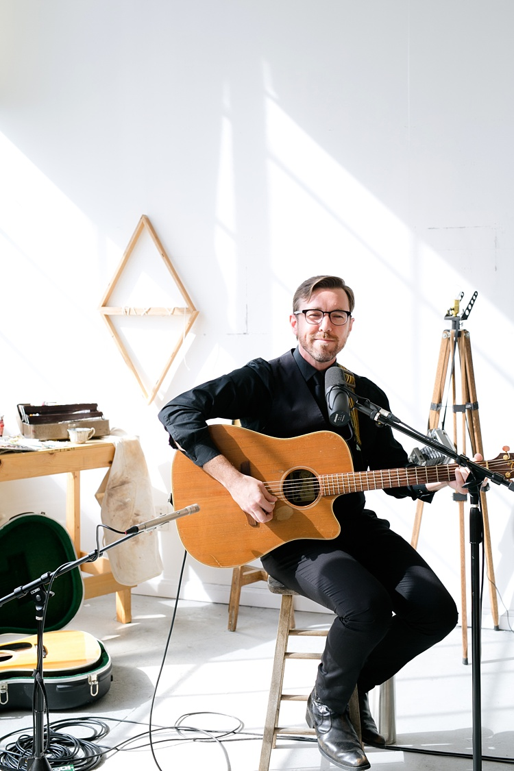 Jefferson Bergey playing the guitar for a video shoot.