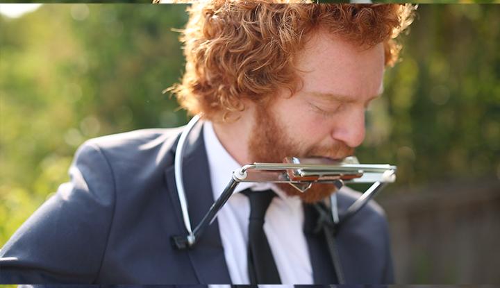 JD Lyon playing the harmonica.