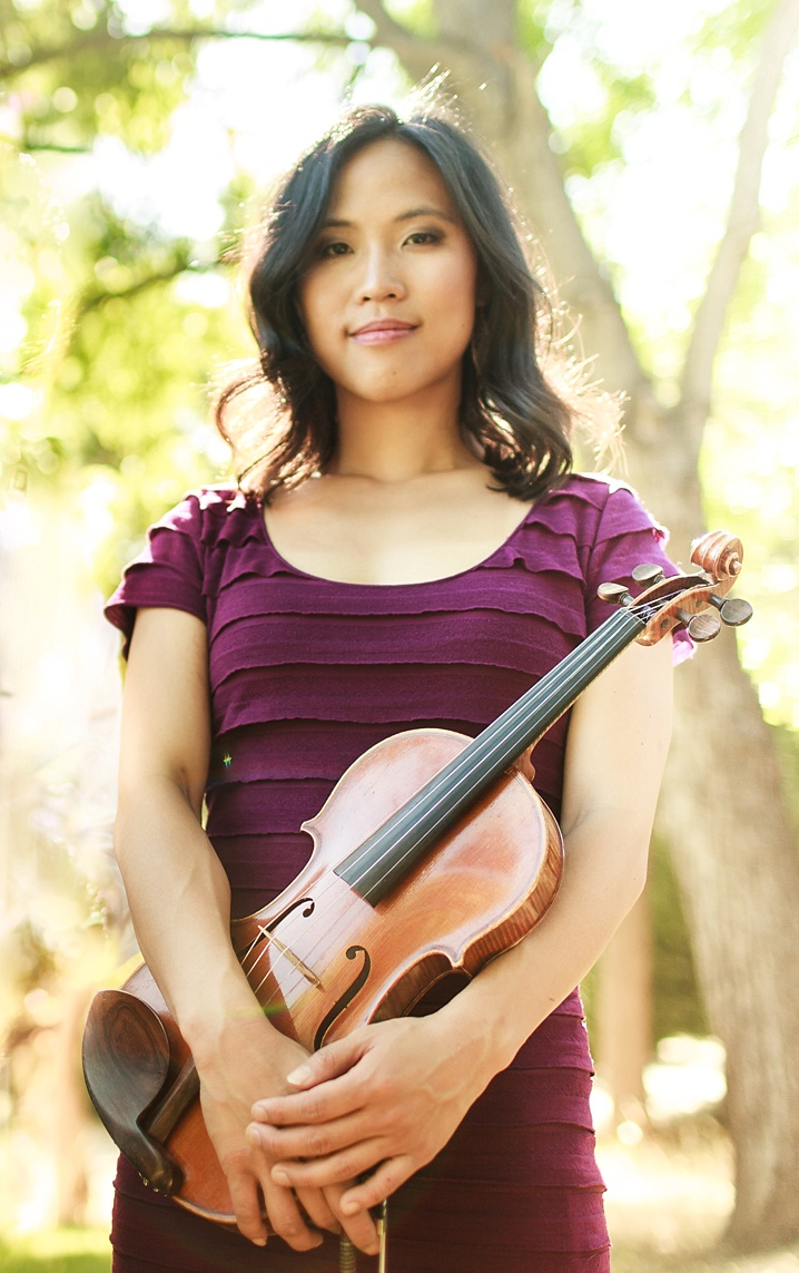 Portrait of MJ Lee. with violin.
