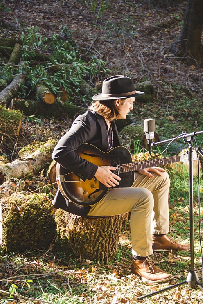 Tim Marconett singing in nature.