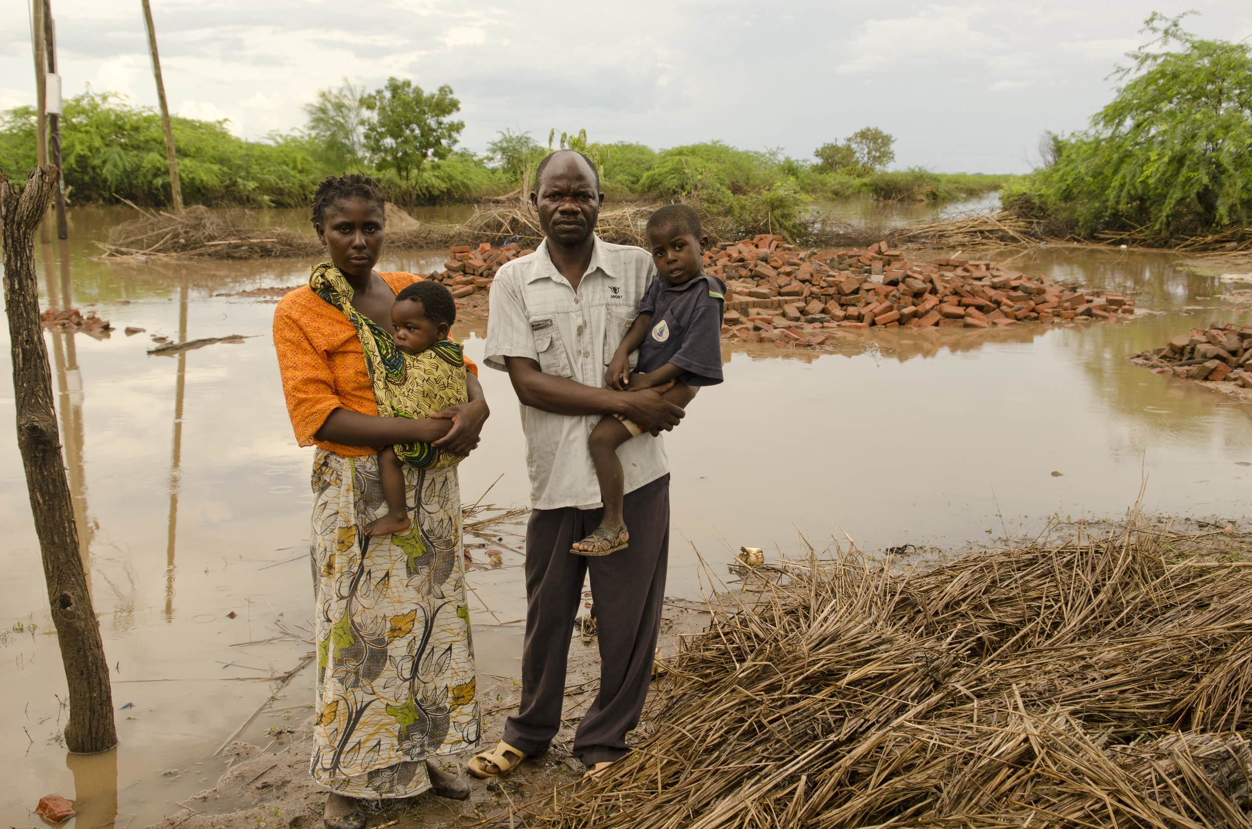 The Damiano family - Tamara, Caroline, Matthews and Precious - in front of what's left of their home in the southern Malawi district of Chikwawa.