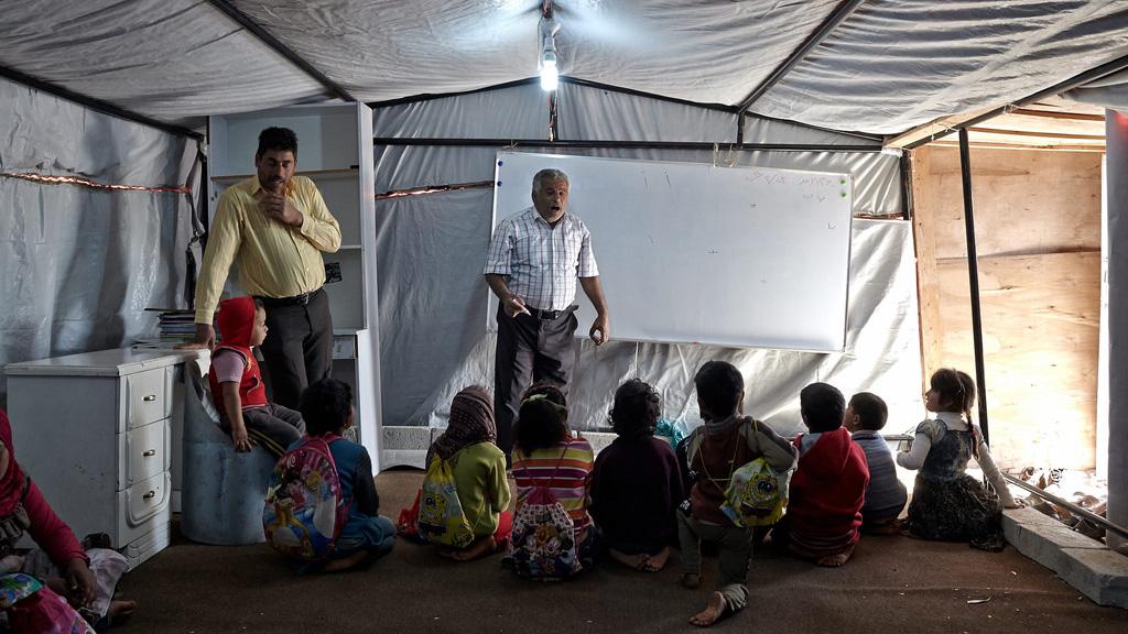 A makeshift tent school for Syrian children in Jordan.  UNHCR/ S. Baldwin