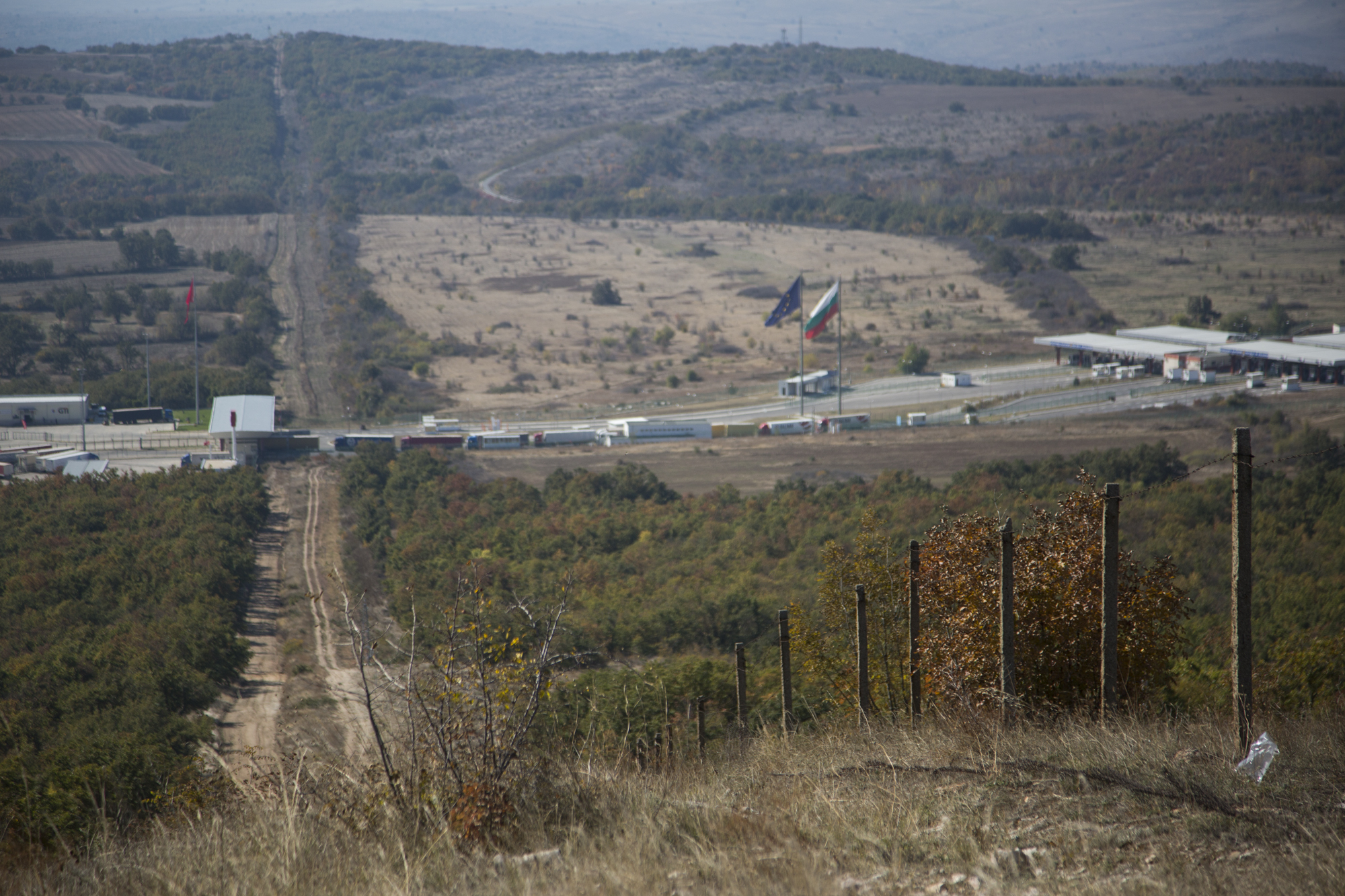 The border between Turkey and Bulgaria is marked by two rows of tracks and a communist-era fence, now in disrepair. It is monitored by security cameras and border police teams.