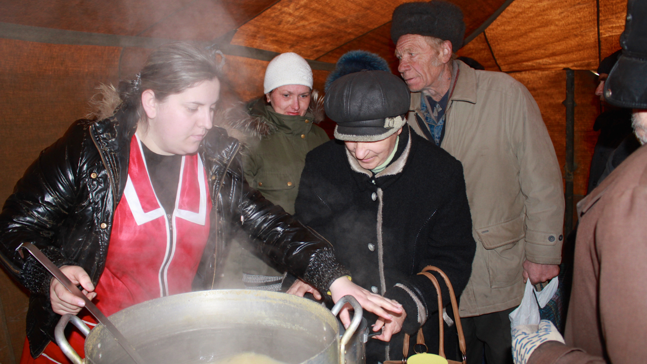Soup kitchens, like this one run by the local Red Cross in Luhansk, are the only source of regular food for some