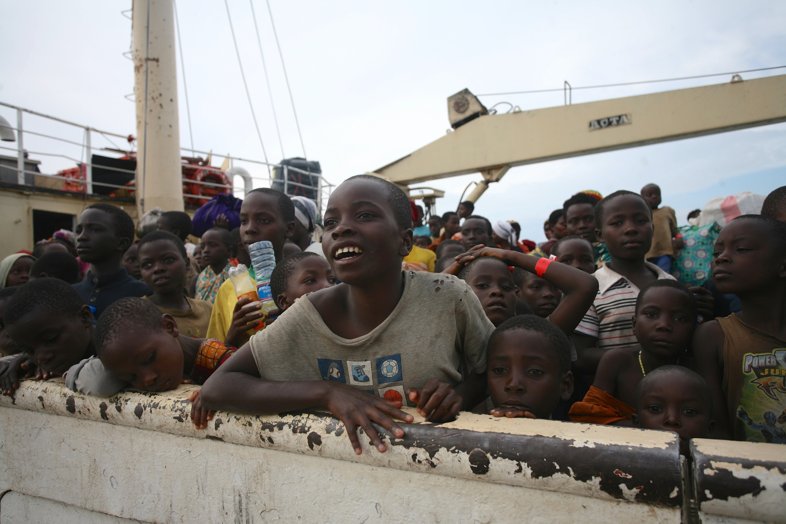 A young Burundian refugee looks out aboard the MV Liemba as it docks in Kigoma, Tanzania