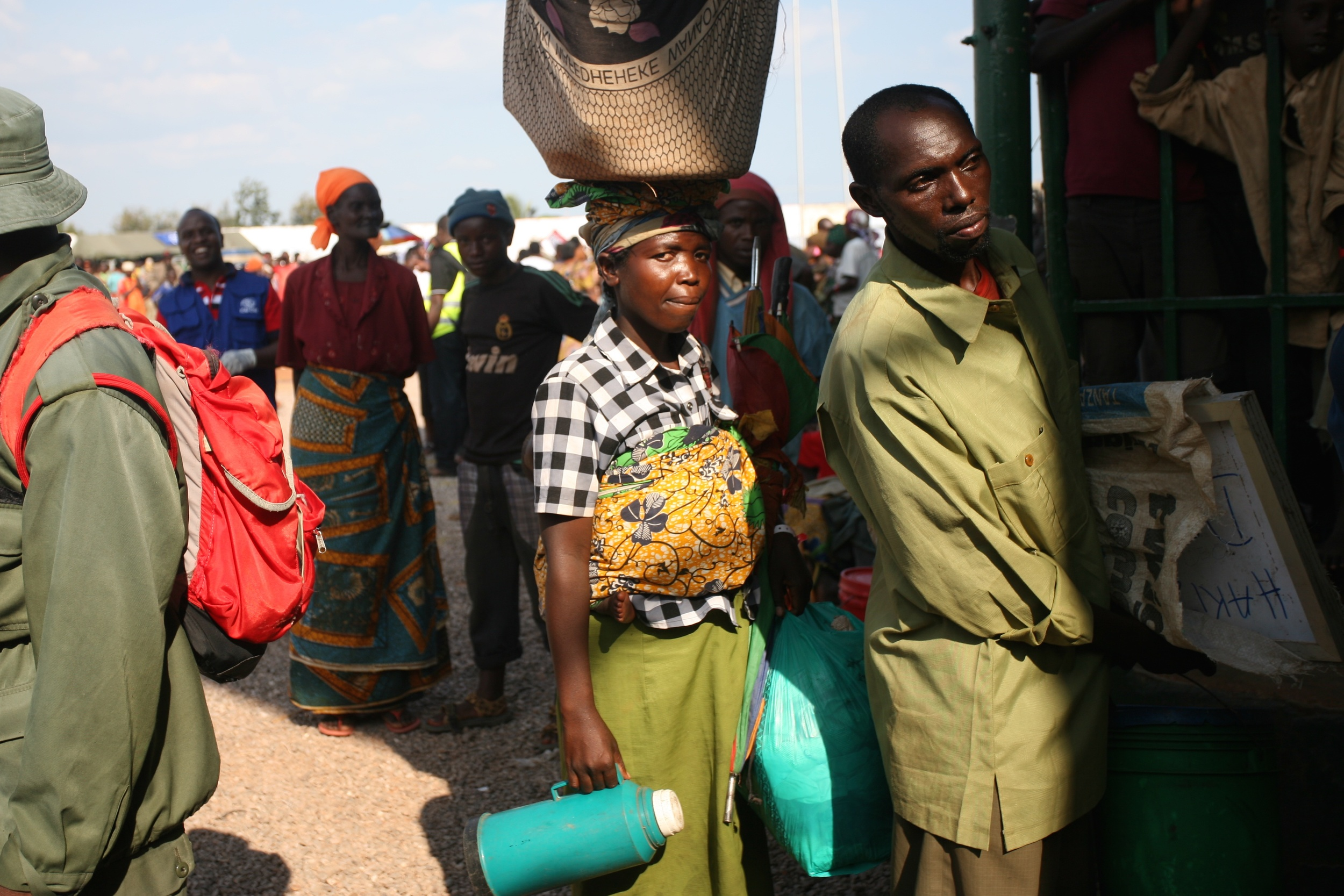 A Burundian refugee queues at Lake Tanganyika Stadium in Kigoma, Tanzania, for the bus taking refugees to a permanent refugee camp