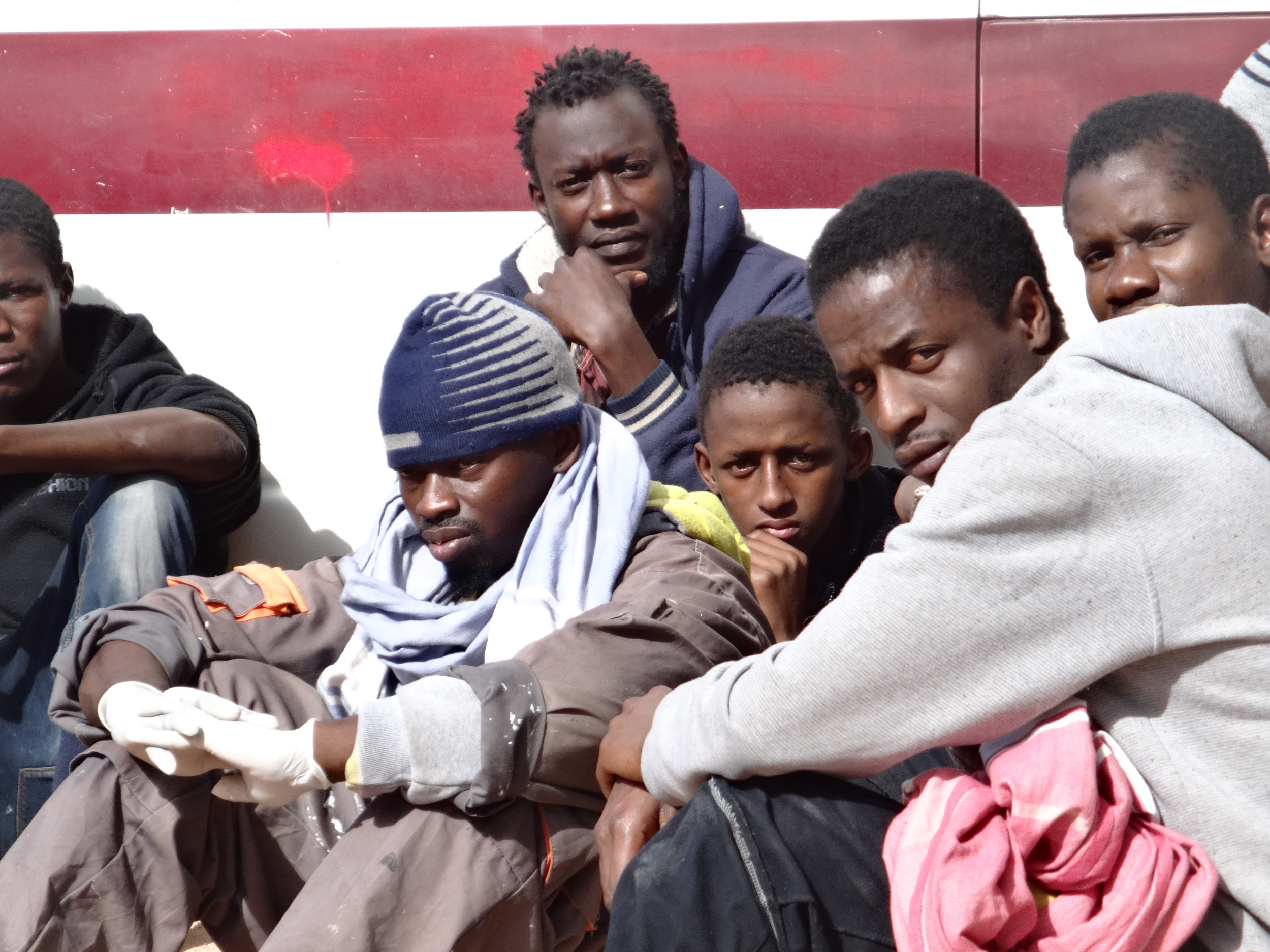 Migrants gather outside the detention centre