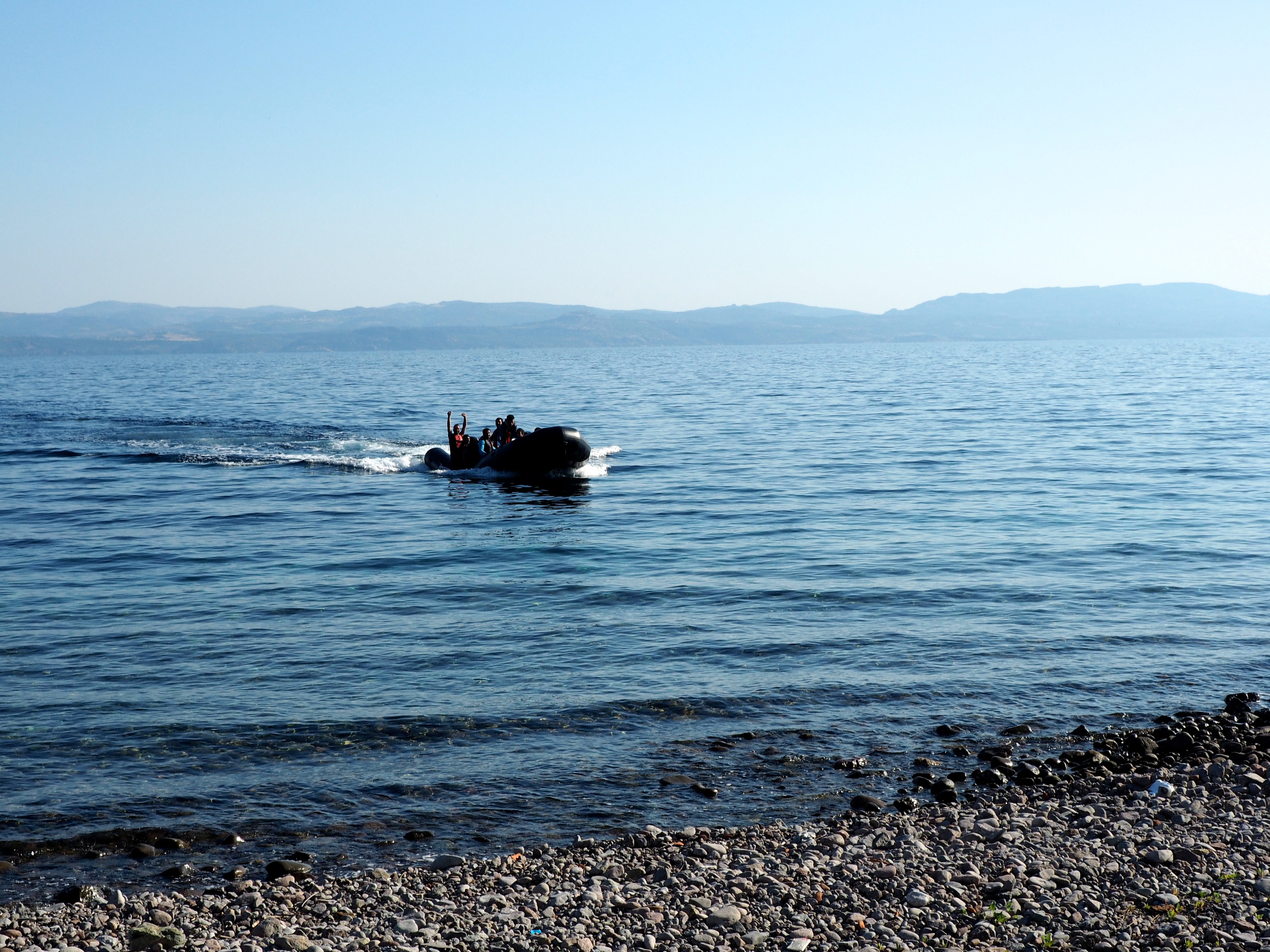 A rubber dinghy carrying migrants approaches the shore at Skala Sykaminias. The sea route from Turkey to Greece is increasingly popular, perhaps because only 31 migrants have died attempting it so far this year compared to the 1,800 who have died trying to reach Italy by boat from Libya.
