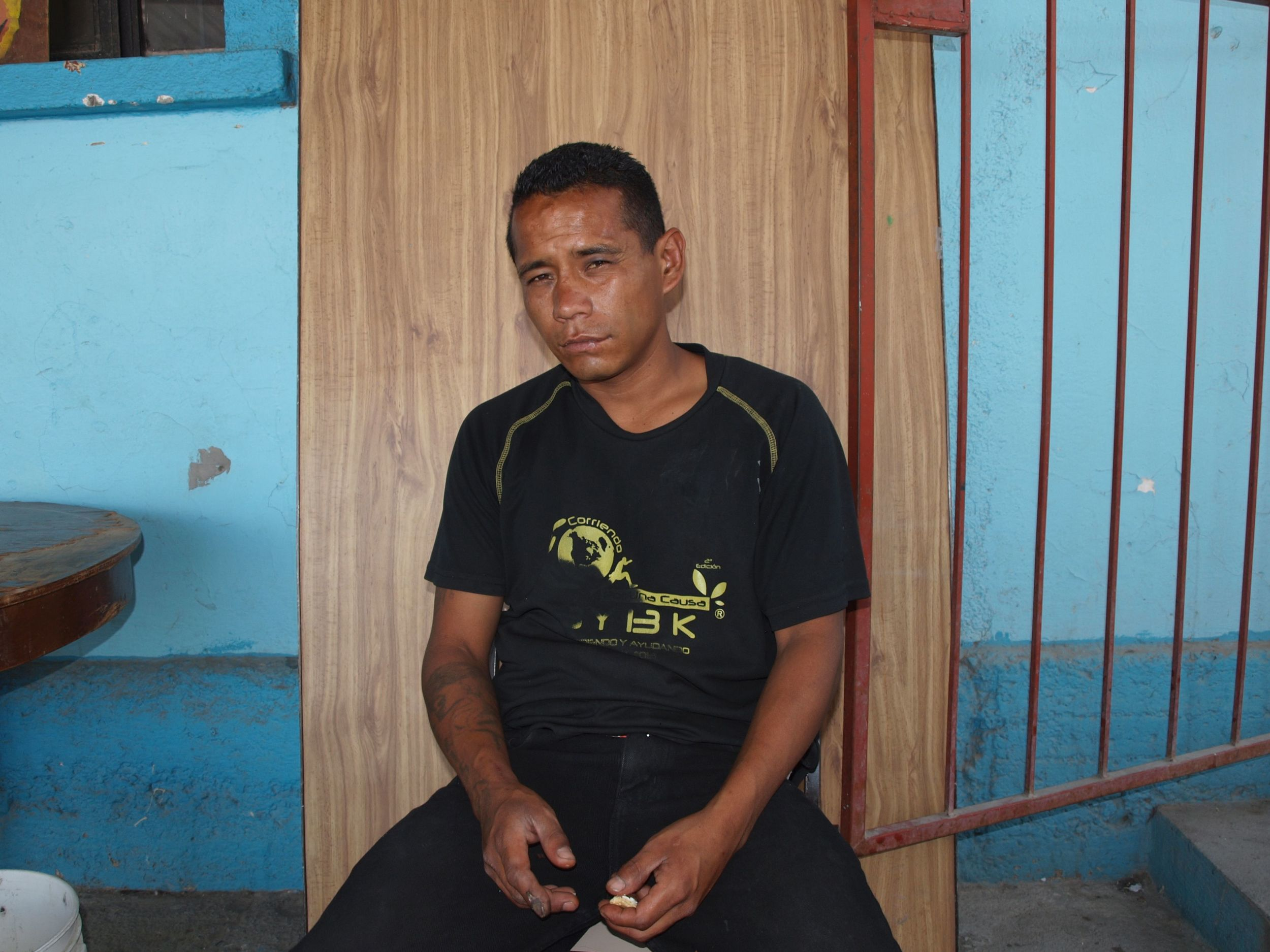 José Noel fell off a train en route to the US and rolled along the track several times. He says his back is injured but he is afraid to go to the hospital.