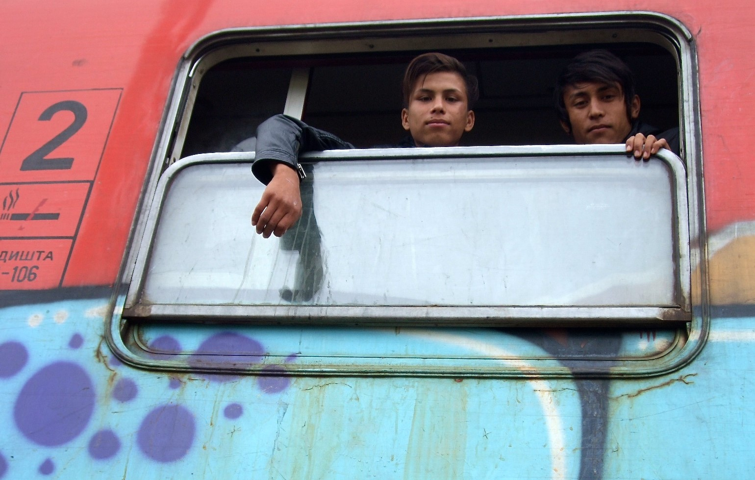 Afghan refugees, Ali and Mohamed, on board the train about to depart for the Serbian border