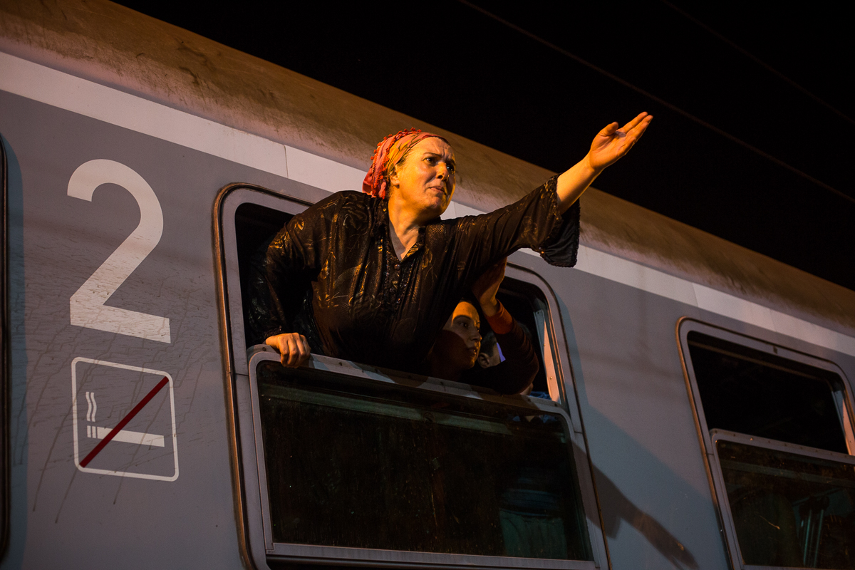 A woman tries to convince police officers to allow her husband to join her on the train, but the doors have already been locked. Families often get separated in the rush to board the train.