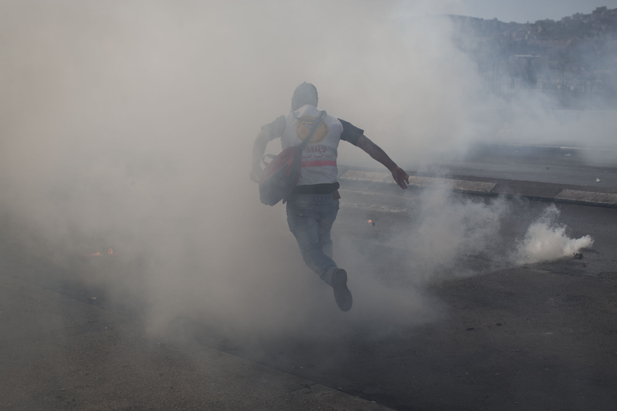 Palestinian first responders work under difficult conditions. They come to clashes prepared with gas masks. Several volunteers have been injured in the line of duty