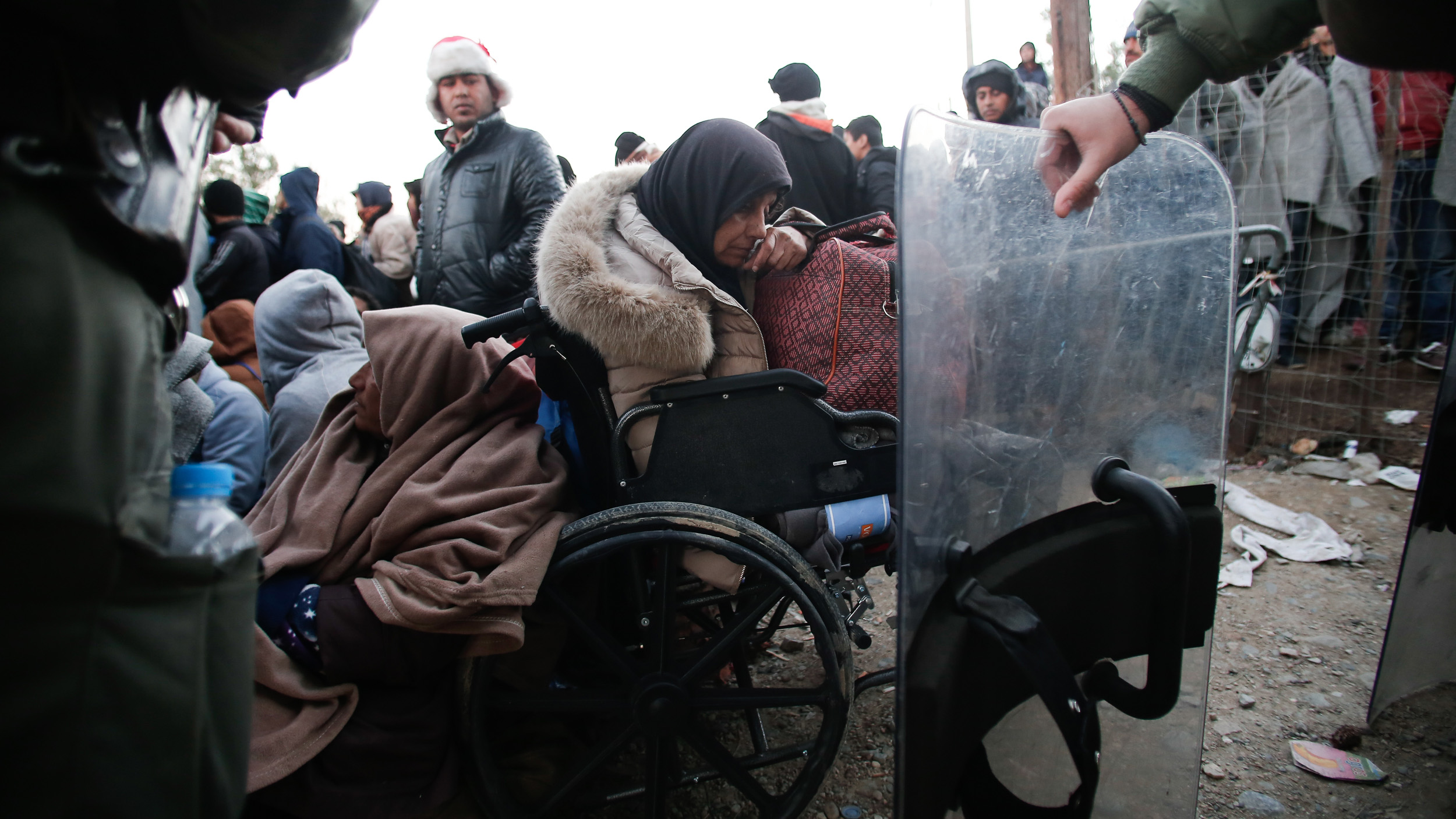 Migrants, even those in wheelchairs, have spent the last two weeks at Greece's border with Macedonia