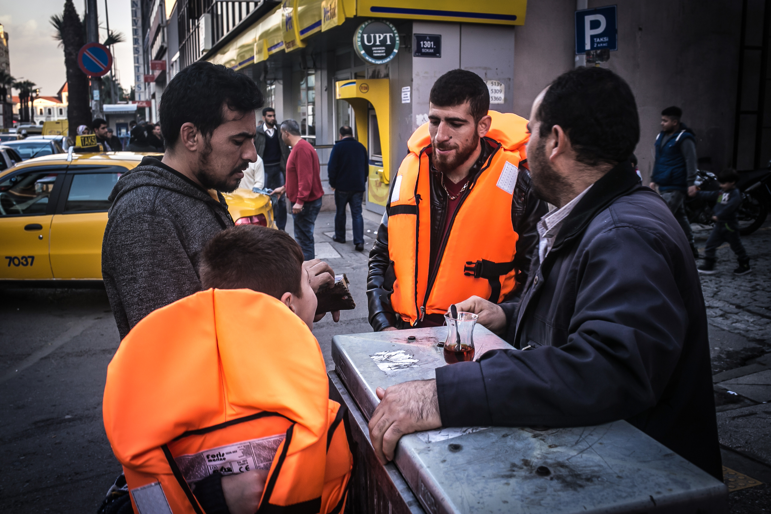 A Syrian refugee buys lifejackets in the streets of Basmane