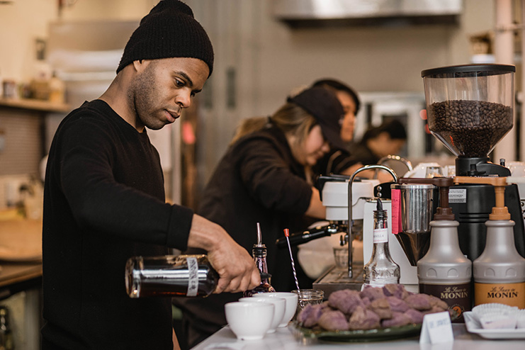 Anton Coleman, lead barista for Hood Famous Cafe + Bar.    Photo by Auriza Ugalino.